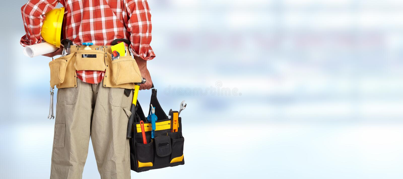 杂物工的手有工具袋的 图库摄影