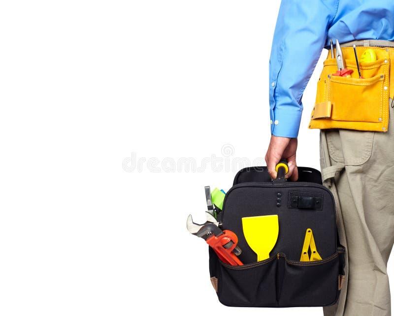 杂物工的手有工具袋的 库存照片