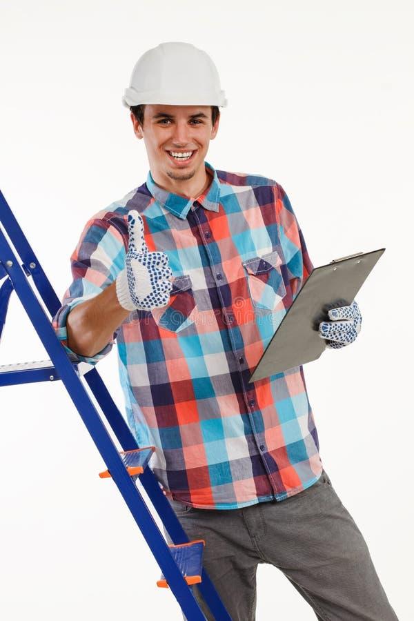 杂物工给翘拇指的待命的梯子 免版税库存照片