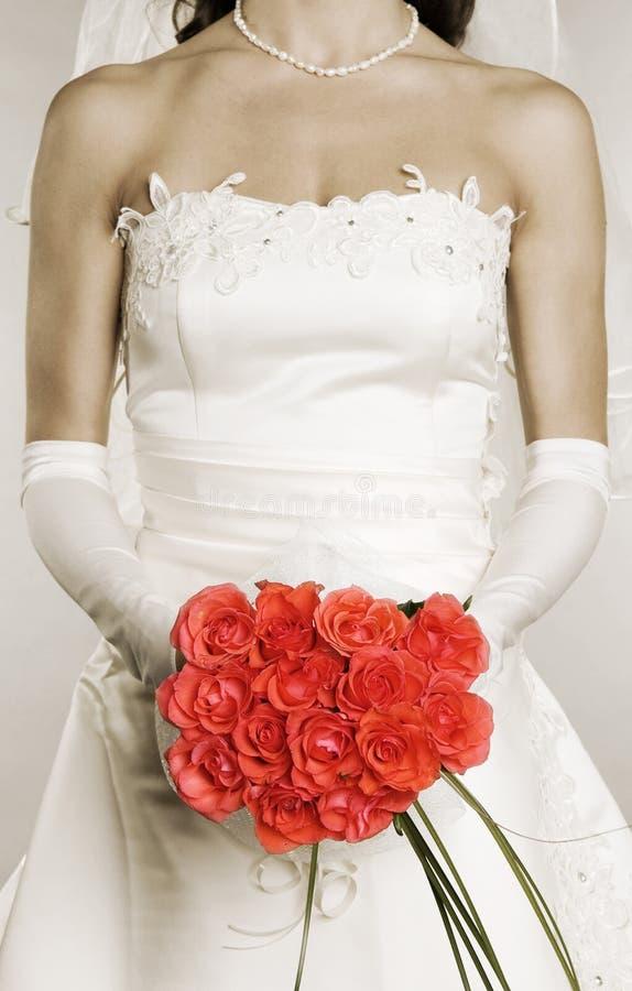 束婚姻妇女的礼服玫瑰 免版税图库摄影