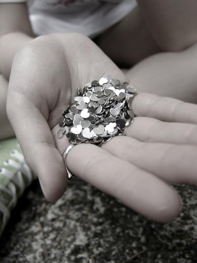 束拿着金属的现有量重点 库存照片