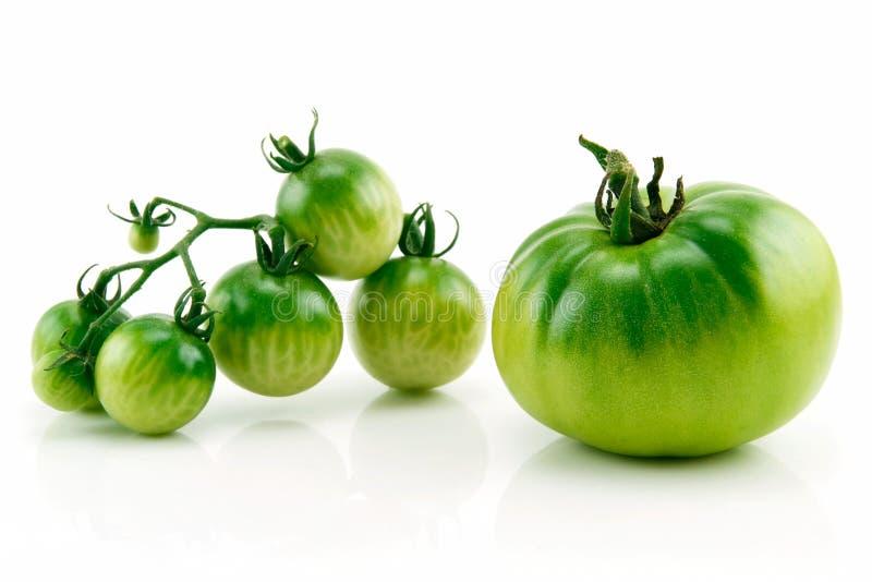 束绿色查出的成熟蕃茄黄色 免版税库存照片