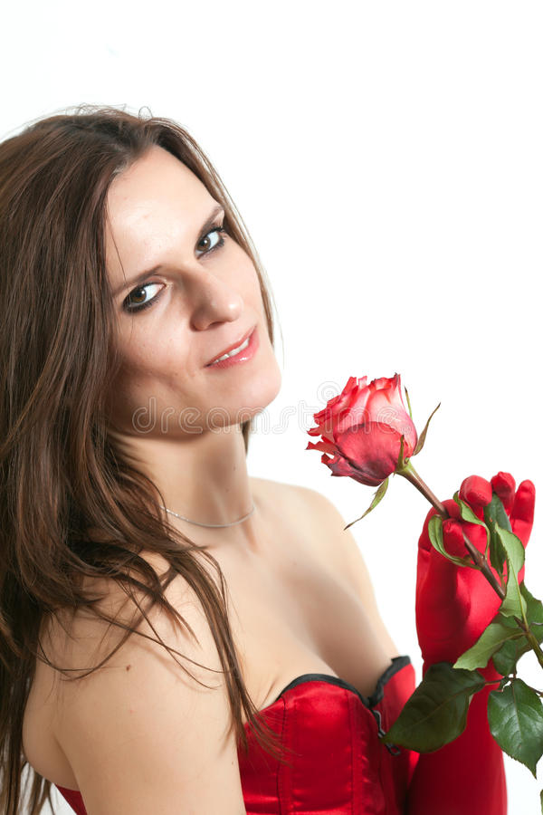 束腰的妇女拿着一朵玫瑰 库存图片