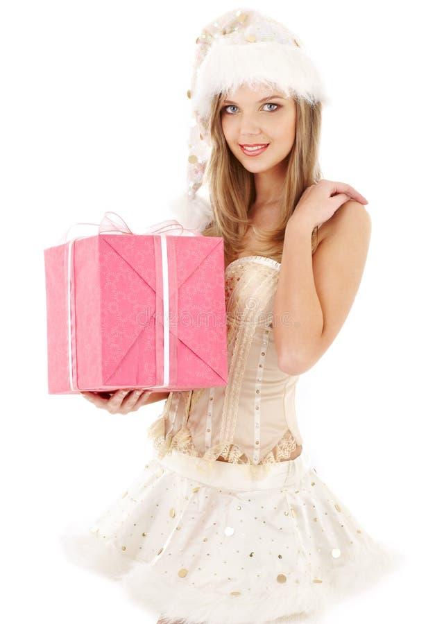 束腰礼品辅助工粉红色圣诞老人裙子 库存图片