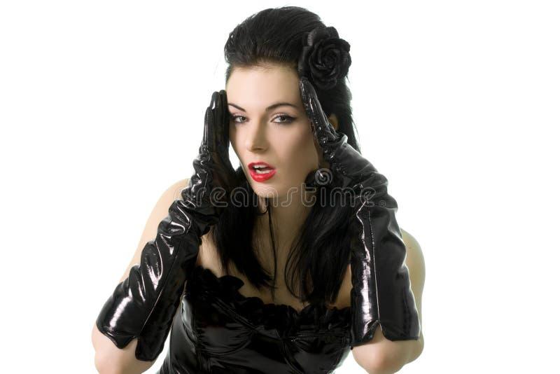 束腰迷信手套查出性感的妇女 免版税库存照片