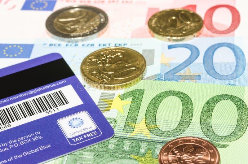 条形码和商标在全球性蓝色卡片反对欧洲货币 库存图片