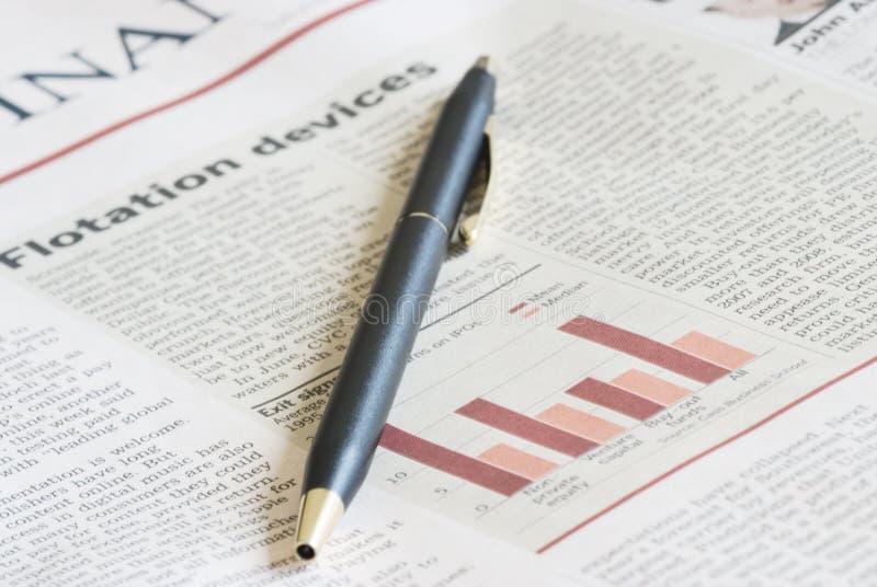条款接近的报纸 免版税库存照片