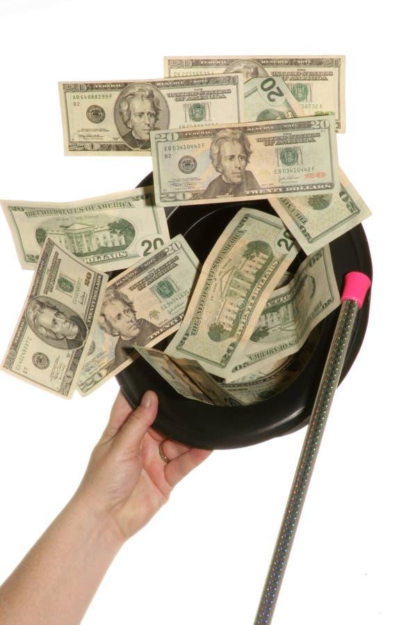 来我帽子的货币当心 库存照片