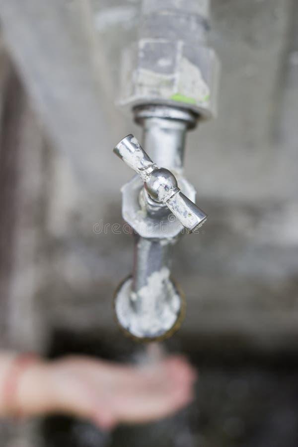 水来自龙头 免版税库存照片