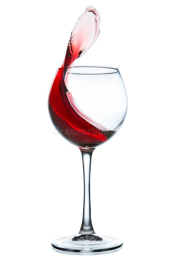 杯在空白背景的红葡萄酒 免版税库存图片