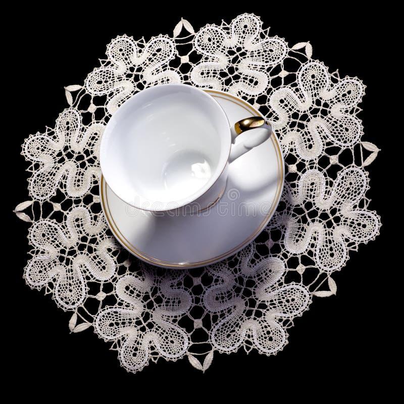 杯子小垫布有花边小 免版税图库摄影