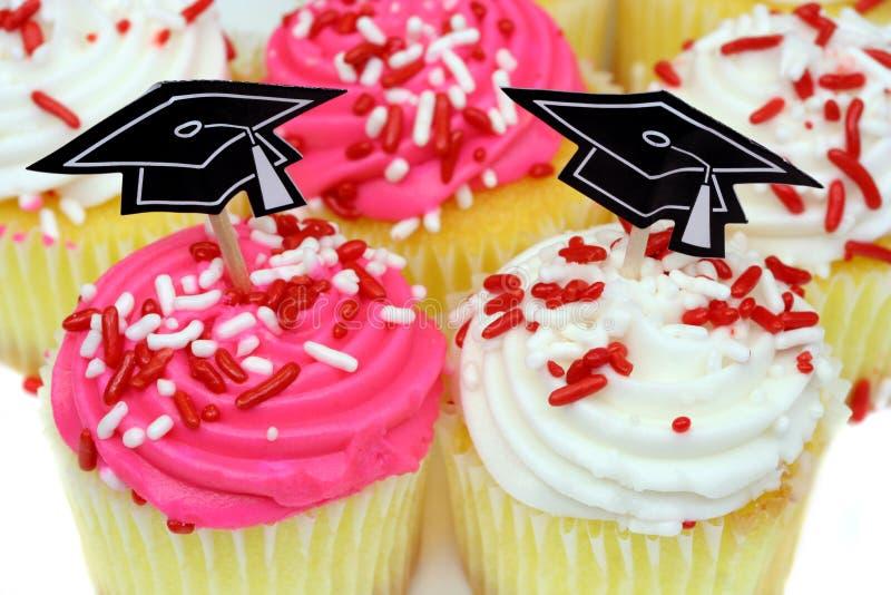 杯形蛋糕毕业 库存图片