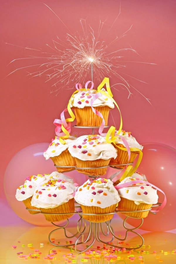 杯形蛋糕闪烁发光物顶层 免版税库存照片