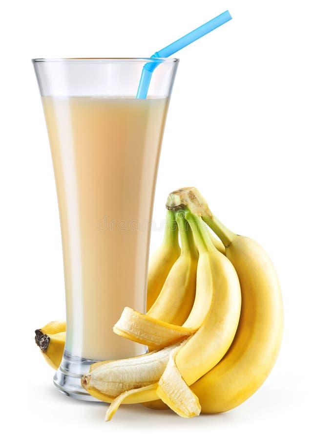 杯香蕉汁用在白色隔绝的果子 免版税库存图片