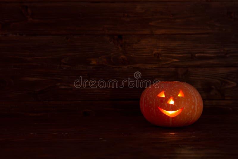 杰克o灯笼在木背景的万圣夜南瓜 库存图片