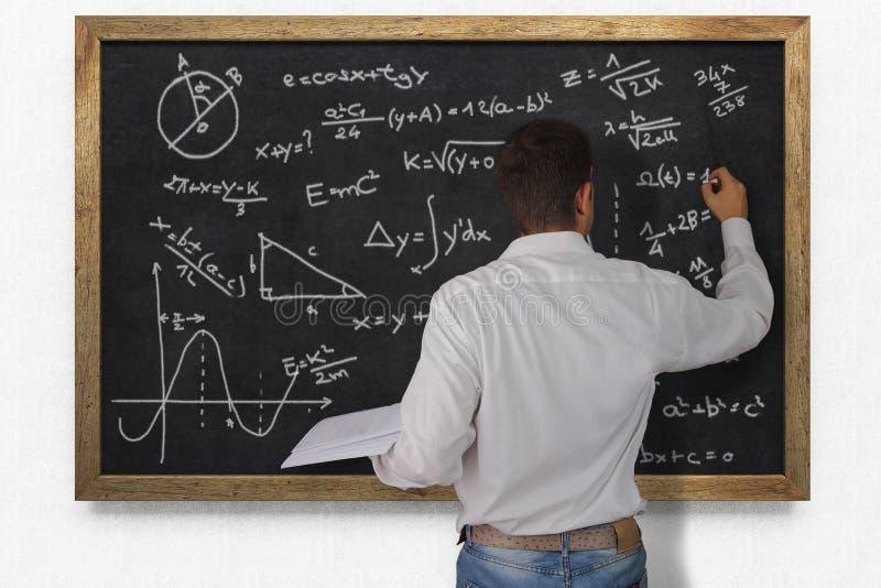 黑板的教师 免版税库存照片