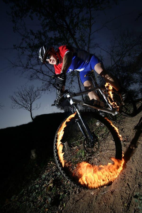 极其的骑自行车的人 库存照片