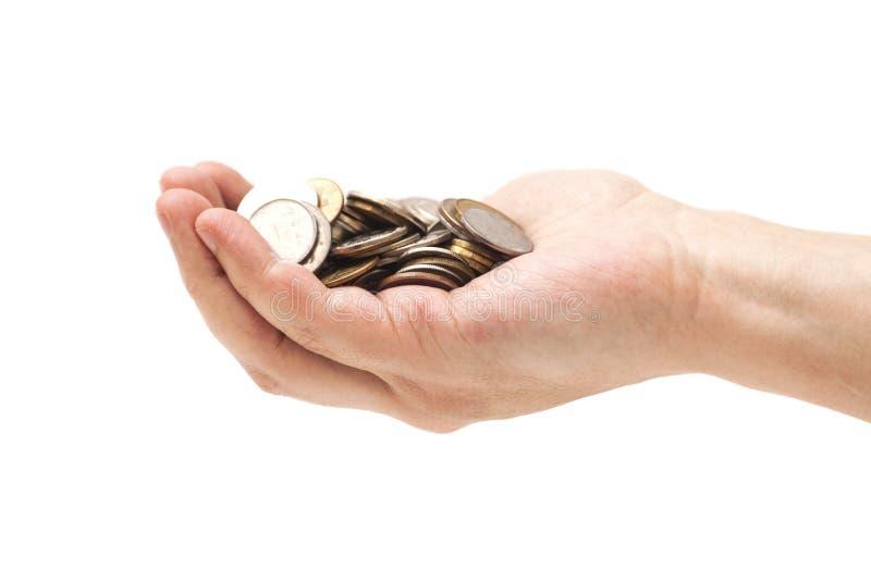 极少数硬币在棕榈手上 库存图片