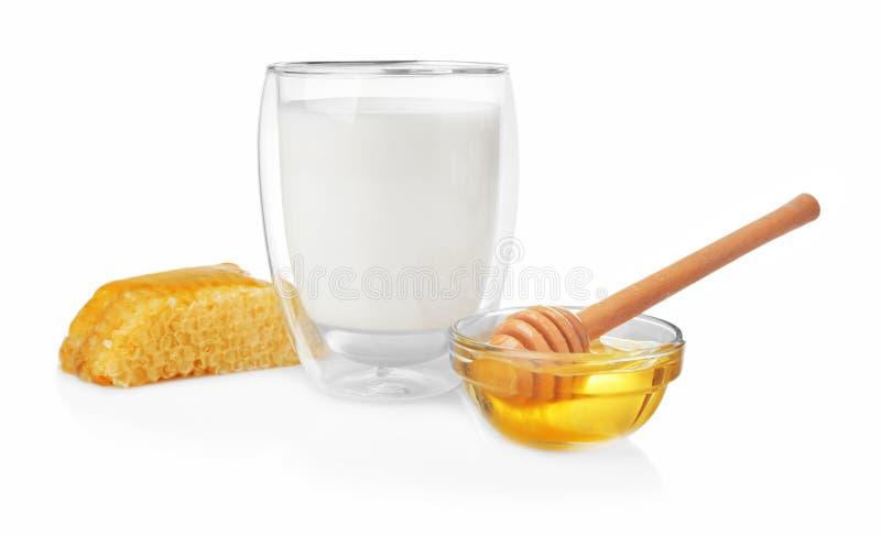 构成用牛奶、蜂蜜和蜂窝 库存图片