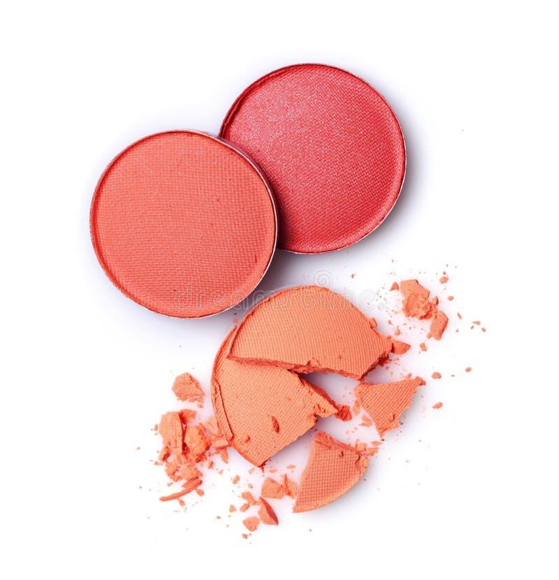 构成的圆的橙色和红色被碰撞的眼影膏作为化妆用品产品样品  图库摄影
