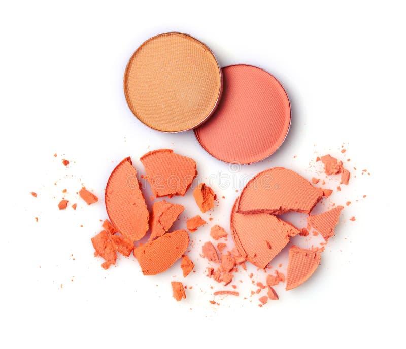 构成的圆的橙色被碰撞的眼影膏作为化妆用品产品样品  免版税库存图片