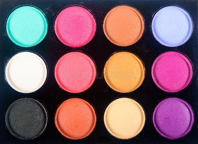 构成眼影膏调色板顶视图  关闭眼影化妆用品的一个五颜六色的分类 特写镜头眼影集合 库存照片