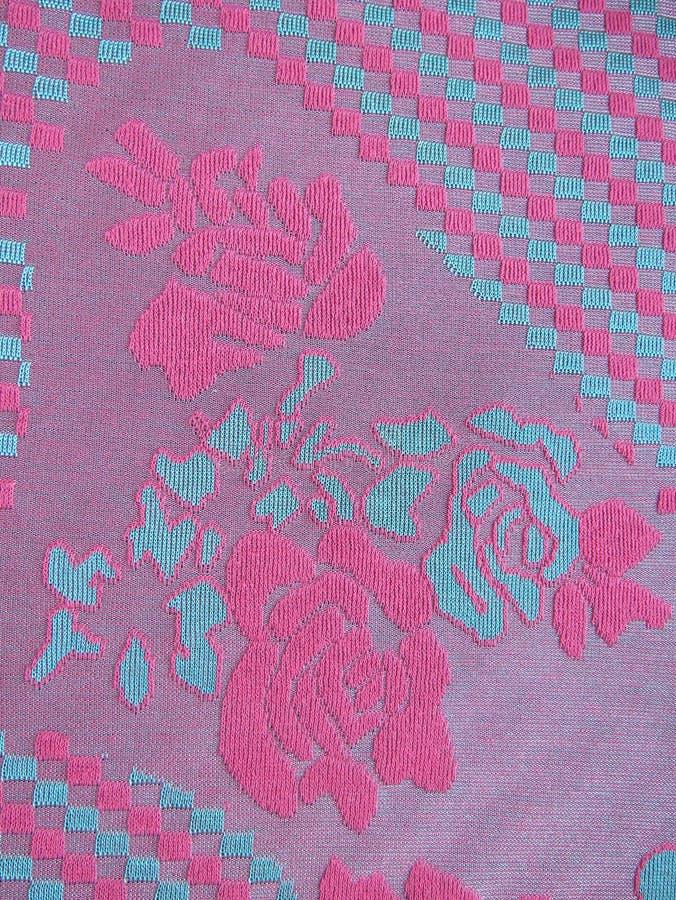构造单位与玫瑰和正方形的被编织的织品 免版税库存图片