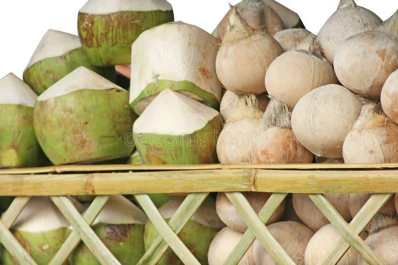构造在白色背景隔绝的被堆积的椰子 免版税库存图片