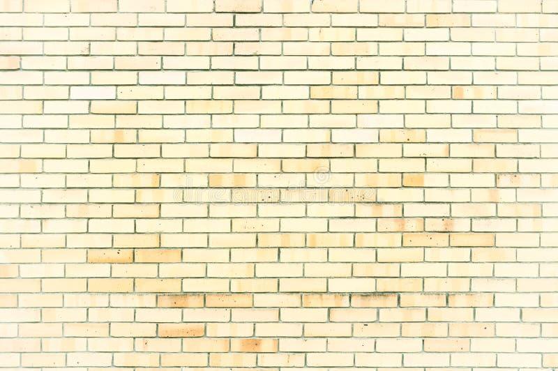 构造淡黄色砖墙,纹理与轻的砖的墙壁表面石背景  库存照片
