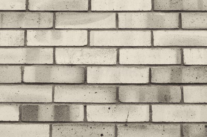 构造灰色砖墙,纹理与灰色砖的墙壁表面石背景  免版税库存图片