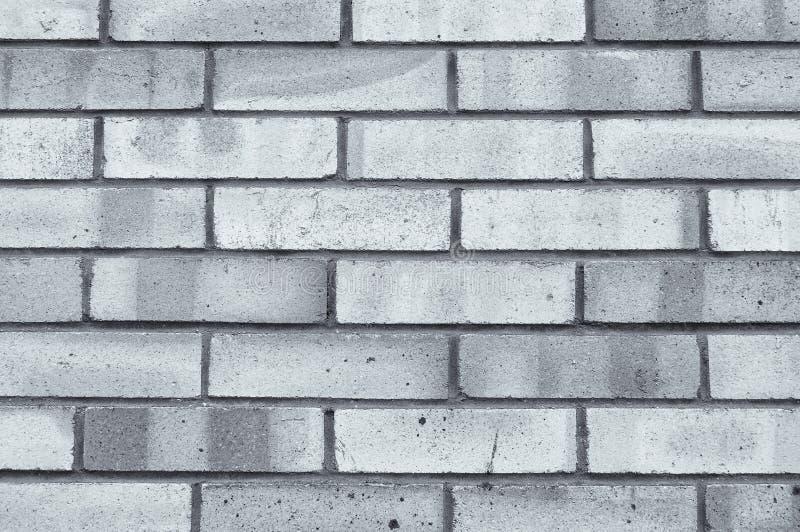 构造灰色砖墙,纹理与红砖的墙壁表面石背景  免版税库存图片