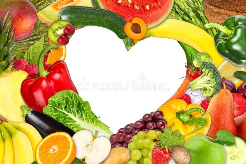 水果和蔬菜心形的框架 库存照片