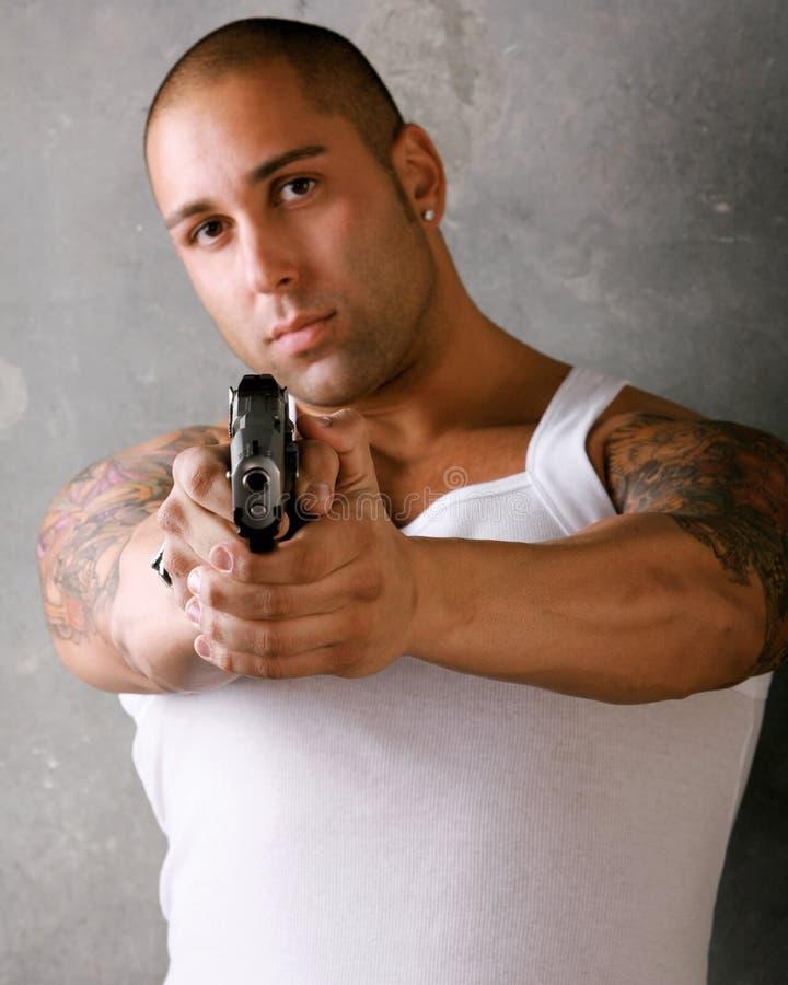 枪人指向 免版税库存照片