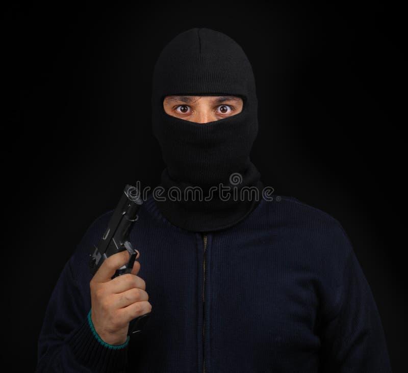 枪屏蔽了窃贼 免版税库存图片