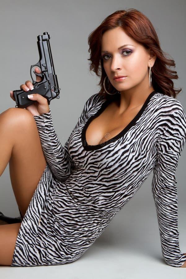 枪性感的妇女 库存图片