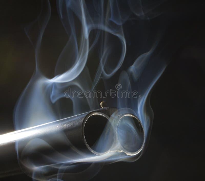 枪抽烟 图库摄影