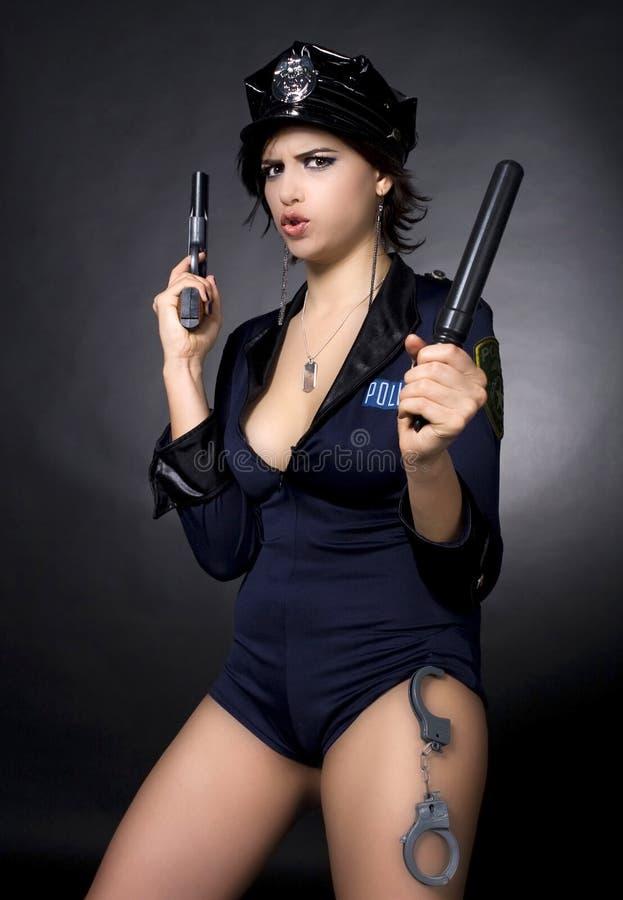 枪藏品警察性感的妇女 库存照片