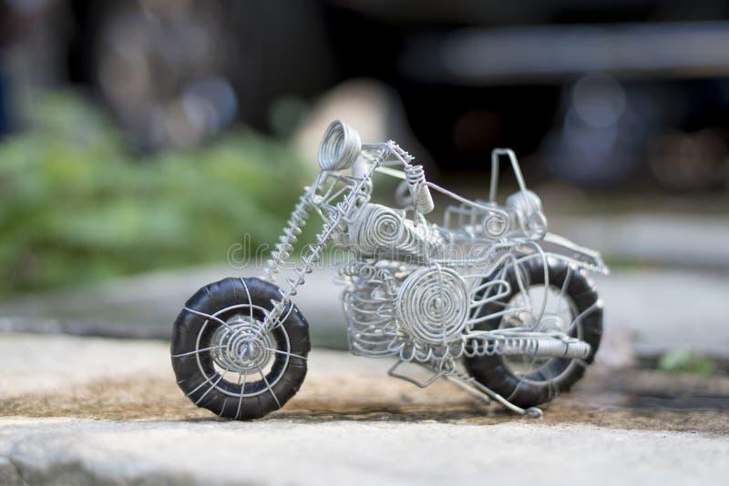 架线做的玩具,它的种类摩托车  免版税库存图片