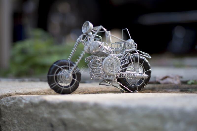 架线做的玩具,它的种类摩托车  图库摄影