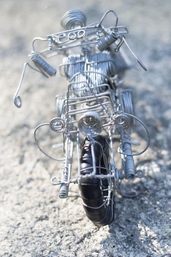 架线做的玩具,它的种类摩托车  库存照片