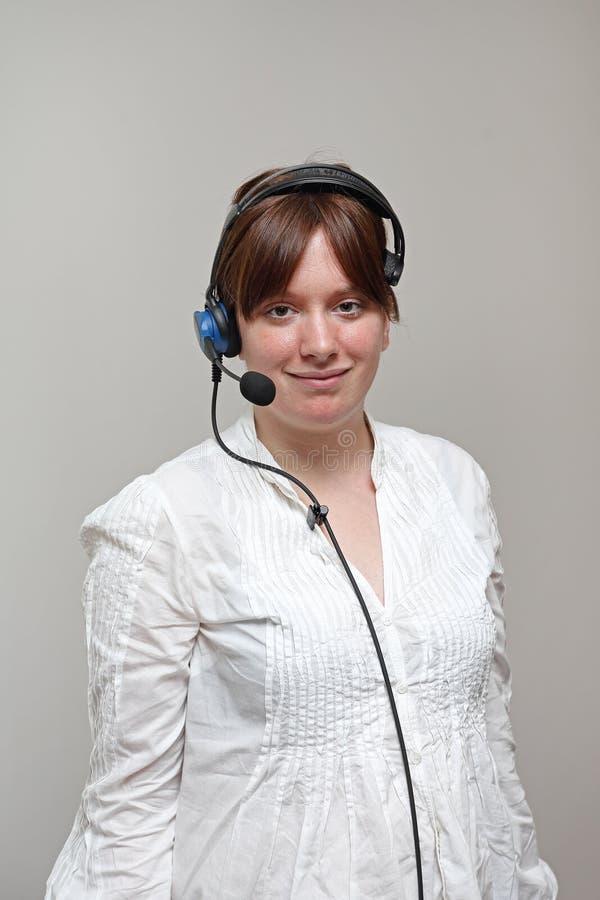 架线的耳机女工 免版税库存照片