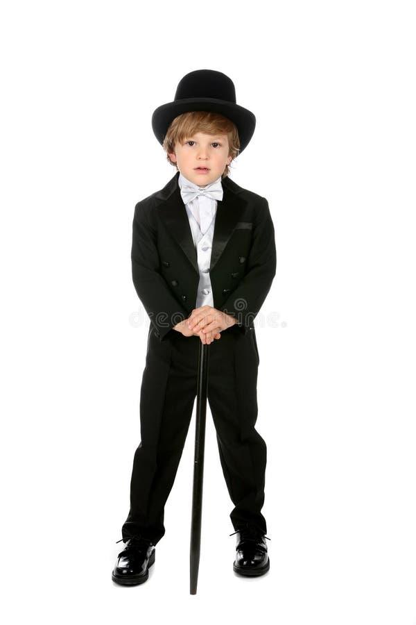 染黑男孩英俊的tophat无尾礼服年轻人 免版税库存照片