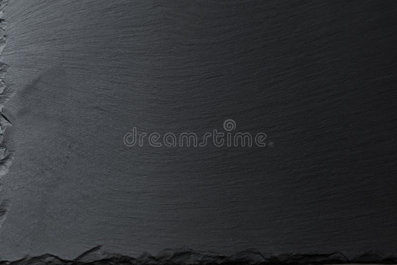 染黑石背景 免版税图库摄影