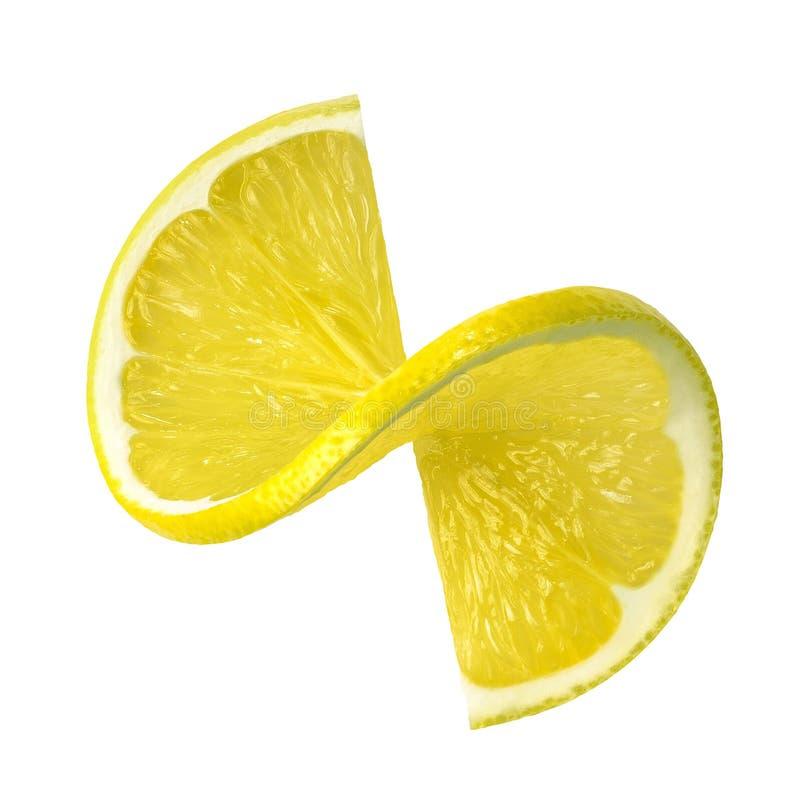 柠檬在白色背景隔绝的转弯切片 库存照片
