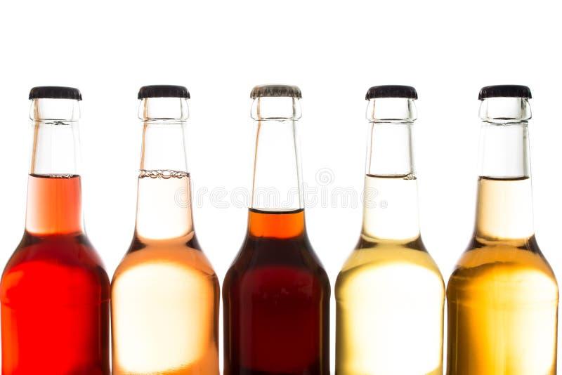 柠檬水和可乐在玻璃瓶 免版税库存图片