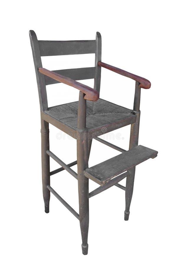 查出的古色古香的木儿童高脚椅子。 免版税库存图片