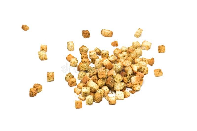 查出的油煎方型小面包片草本 免版税库存照片