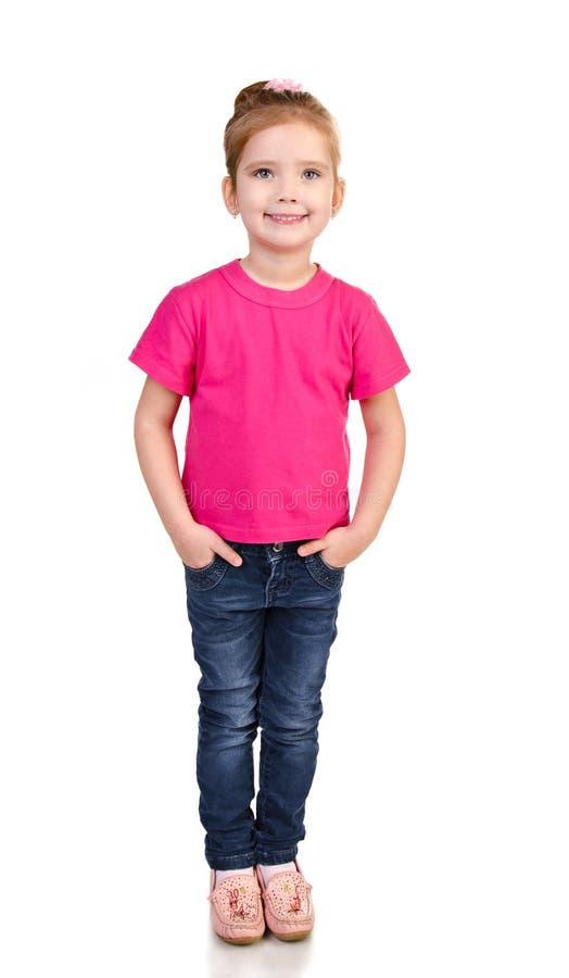 查出的牛仔裤和T恤杉的逗人喜爱的小女孩 库存照片