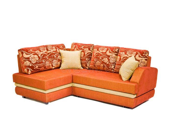 查出的现代橙色沙发白色 免版税库存照片