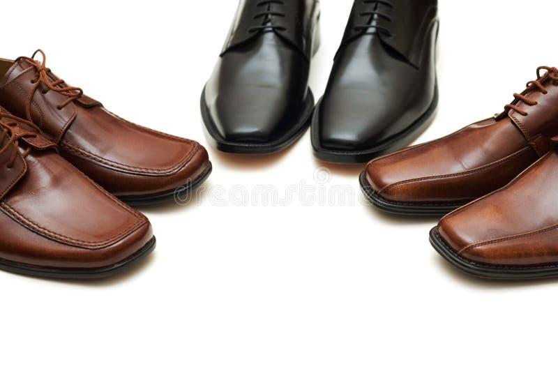 查出的男鞋子多种白色 免版税库存照片